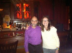 Susan Tepper hosts her reading series FIZZ at KGB Bar, NYC, for 7 years, shown here with writer/reader Eric Darton.